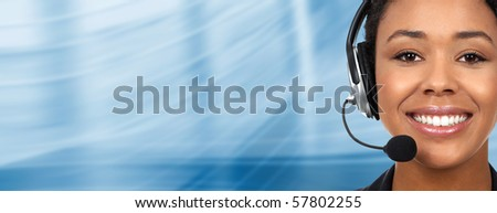 Beautiful  business woman with headset. Over blue  background - stock photo