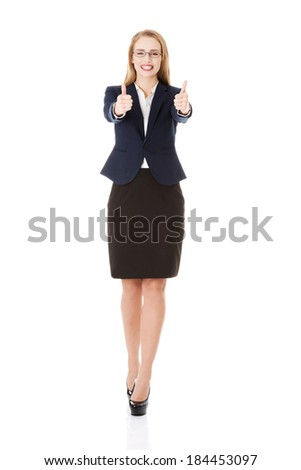 Beautiful business woman with her thumb up, showing oK. Isolated on white. - stock photo