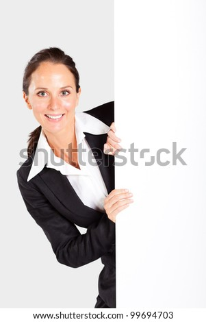 beautiful businesswoman behind white board - stock photo