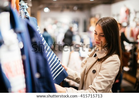 Beautiful businesswoman buying clothes - stock photo