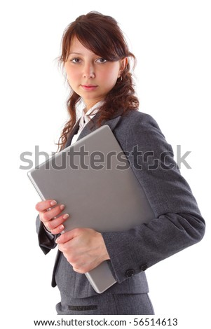 beautiful businesswoman carrying a laptop isolated on white background - stock photo