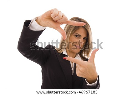 Beautiful businesswoman doing a frame with her hands - stock photo