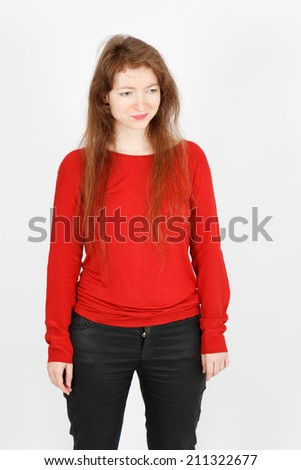 Beautiful businesswoman doing different expressions in different sets of clothes: sad - stock photo