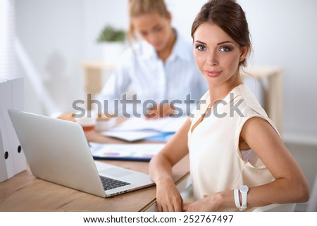 Beautiful  businesswoman enjoying coffee in bright office, sitting - stock photo