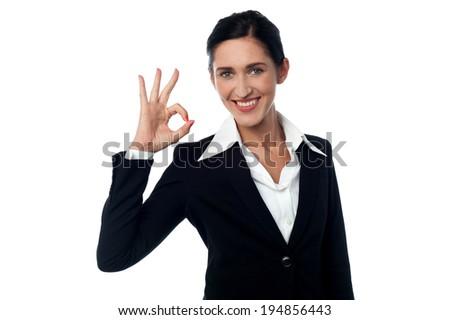Beautiful businesswoman gesturing an excellent job sign - stock photo