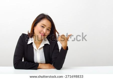 Beautiful businesswoman hand up - stock photo