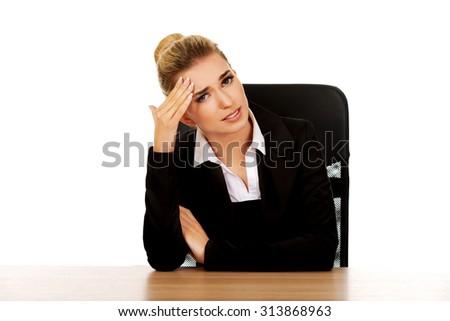 Beautiful businesswoman having huge headache. - stock photo