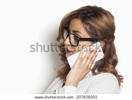 Beautiful businesswoman listening to a phone call - stock photo