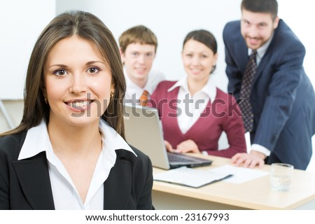 Beautiful businesswoman on the background of team - stock photo