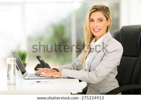 beautiful businesswoman using laptop computer in office - stock photo