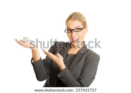 Beautiful businesswoman with plane toy in hand - stock photo