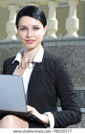 Beautiful businesswoman working outdoor - stock photo