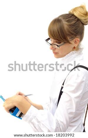 Beautiful businesswoman writes in folder, isolated on white - stock photo