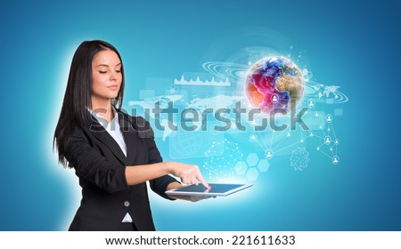 Beautiful businesswomen in suit using digital tablet. Earth with world map, graphs and network. Element of this image furnished by NASA - stock photo