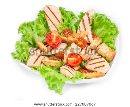 Beautiful caesar salad. Isolated on a white background. - stock photo