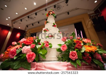 Beautiful Cake decorate with pink rose, flower and candle for Wedding Ceremony - stock photo