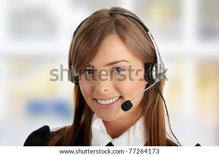 Beautiful Call Center Woman Wearing A Telephone Headset - stock photo