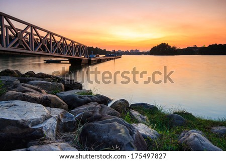 Beautiful calmly sunset a the jetty. - stock photo