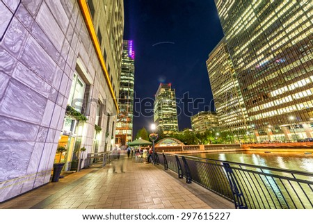 Beautiful Canary Wharf skyline at night, London from street level. - stock photo