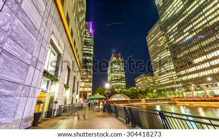 Beautiful Canary Wharf skyline at night, London from street level. - stock photo