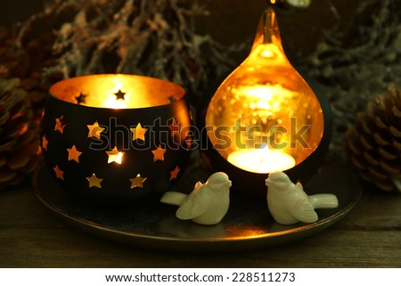 Beautiful candlesticks and other decorations for home interior on dark background - stock photo