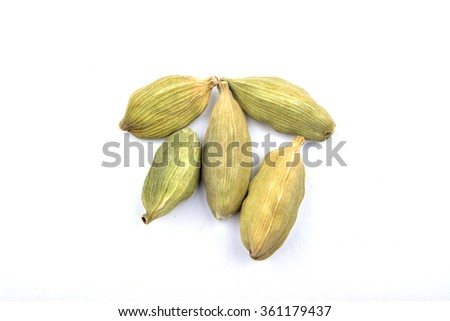 beautiful cardamom pods, on top of carrara marble coutertop. - stock photo