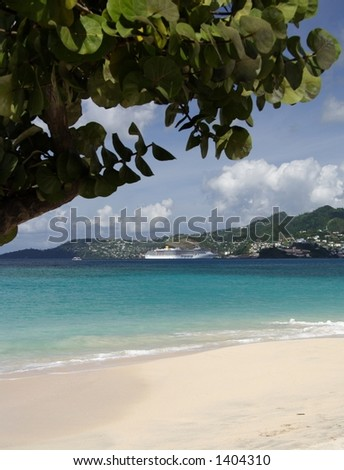Beautiful caribbean beach with a cruiseship in the background - stock photo