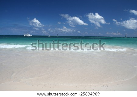 Beautiful Caribbean tropical beach with white sand and green ocean, suitable background for a variety of designs - stock photo