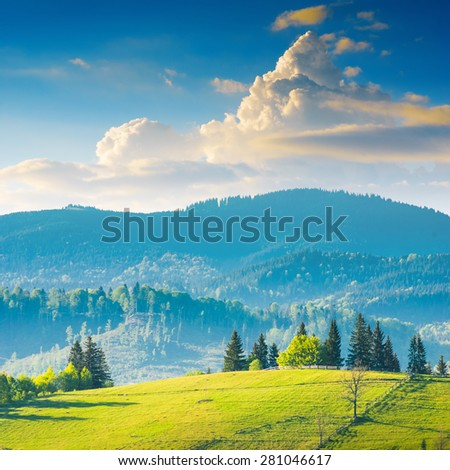 Beautiful Carpathian mountain valley with colorful clouds in a sunset light. Majestic landscape - stock photo