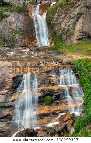 Beautiful cascading waterfall in West Sikkim in the Himalayas - stock photo