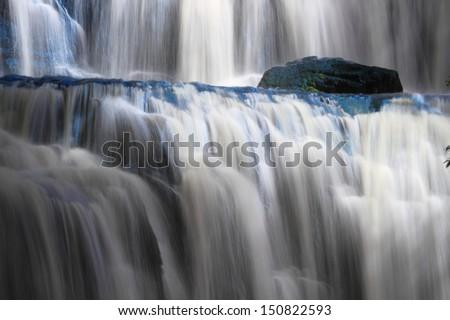 Beautiful cascading waterfall. Purakaunui waterfall, Catlins, Southland, New Zealand - stock photo