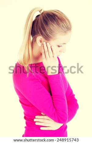 Beautiful casual woman is touching her temples. - stock photo