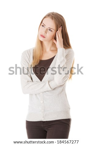 Beautiful casual woman looks worried. Isolated on white. - stock photo