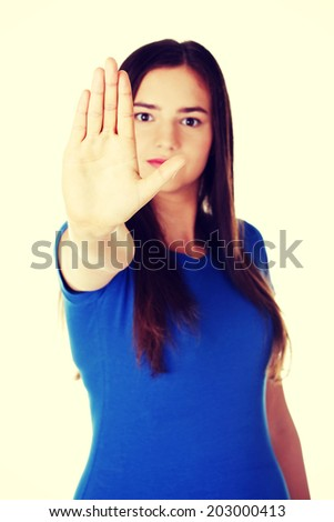 Beautiful casual woman showing stop gesture. Isolated on white. - stock photo