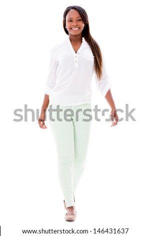 Beautiful casual woman walking - isolated over a white background  - stock photo