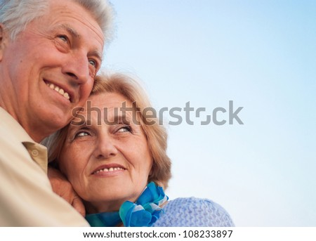 Beautiful Caucasian aged couple in the street - stock photo