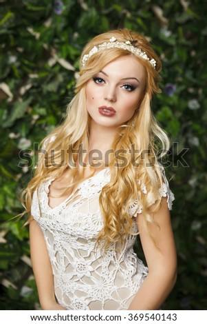 Beautiful caucasian blond model with coronet, portrait shot - stock photo