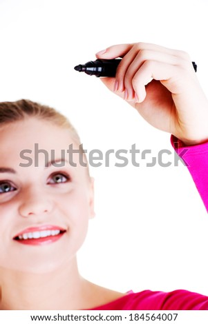 Beautiful caucasian blond woman writing on copy space. Focus on hand. Isolated on white. - stock photo