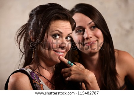 Beautiful Caucasian brunette and friend admiring something - stock photo