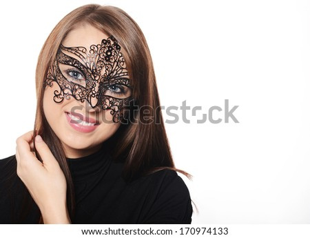 Beautiful caucasian brunette in red carnival mask over white background - stock photo