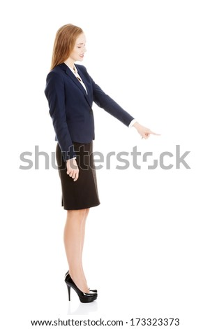Beautiful caucasian business woman advertising. Isolated on white. - stock photo