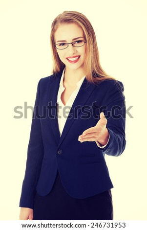 Beautiful caucasian business woman giving a hand.  - stock photo