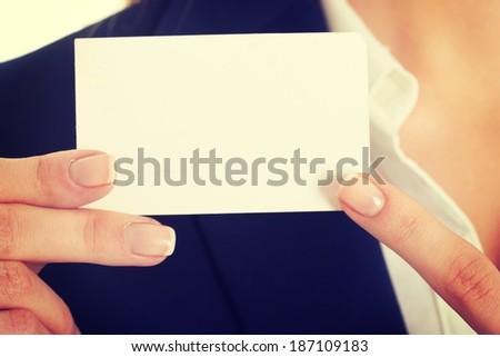Beautiful caucasian business woman holding small personal card. - stock photo