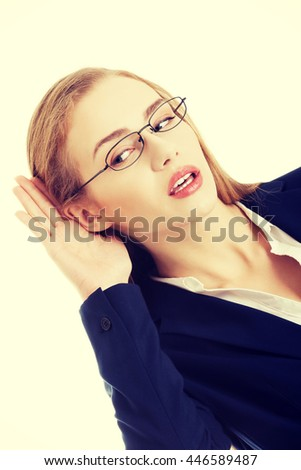 Beautiful caucasian business woman is overhearing. - stock photo