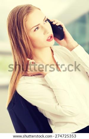 Beautiful caucasian business woman is talking through phone. - stock photo
