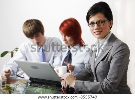 beautiful caucasian business women with young consultant - stock photo