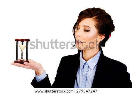 Beautiful caucasian businesswoman holding hourglass. - stock photo