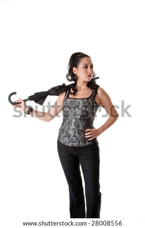 Beautiful caucasian female wearing gray tank top and jeans and hand on hip, carrying unbrella in neck, isolated - stock photo