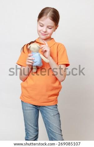 Beautiful caucasian little girl with teddy bear - stock photo