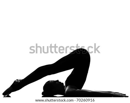 beautiful caucasian tall woman ballet dancer halasana Shoulder Stand yoga pose full length on studio isolated white background - stock photo